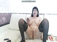 Dark-haired French mature woman penetrates her lil vagina with a dildo